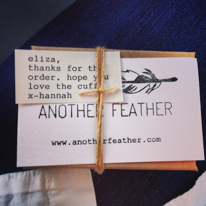 The packaging and note from Another Feather
