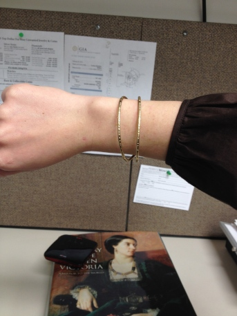 The curved bow cuff on my wrist