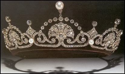 The Lotus Flower tiara, also called the Papyrus tiara. The tiara is composed of a series of fanned motifs separated by scrolled palmettes, and framed by diamond arches with diamond and pearl surmounts.